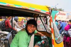 Young man driving tuk-tuk at Kinari Bazaar in Agra, Uttar Prades. H, India. Agra is one of the most populous cities in Uttar Pradesh Royalty Free Stock Image