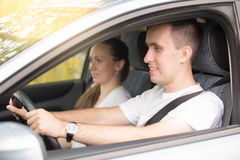Young man driving and woman sitting near in the car stock photos