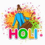 Young man with drum for Happy Holi festival celebration. Stock Images