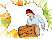 Young man with drum for Happy Holi festival celebration. Stock Photo