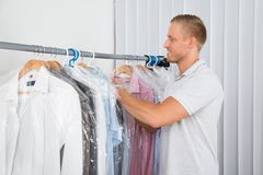 Young man in dry cleaning store Stock Photo