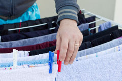 Young man drying clothes after laundry Royalty Free Stock Photography