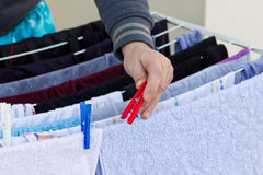 Young man drying clothes after laundry Stock Photo