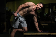 Young Man With Dumbbell Exercising Triceps Royalty Free Stock Images