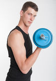 Young man with dumbbell Royalty Free Stock Photos