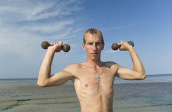 Young man with dumbbells. Stock Image