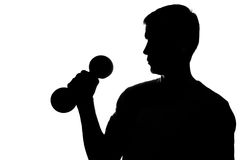 Young man with dumbbells in hand Royalty Free Stock Images