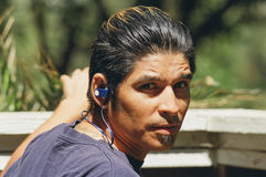 Young Man with Ear Buds Royalty Free Stock Photography