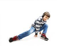 Young man with ear-phones dancing hip-hop Stock Photo