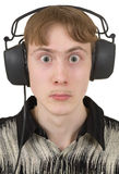 Young man in ear-phones with protruding eyes Stock Photography