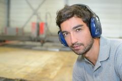 Young man with earmuffs royalty free stock images