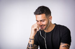 Young man with earphones listening to music Stock Photos