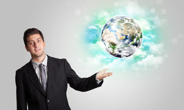 Young man with earth and cloud concept Royalty Free Stock Image
