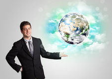 Young man with earth and cloud concept Royalty Free Stock Photo