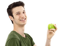 Young man eat green apple Royalty Free Stock Photo
