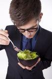 Young man eating. Salad Royalty Free Stock Photo