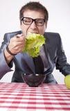 Young man eating. Salad Stock Photography