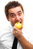 Young man eating apple Royalty Free Stock Photo