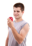 Young man eating apple Stock Photo