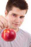 Young man eating apple Royalty Free Stock Images