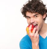 Young Man Eating Apple Stock Photography