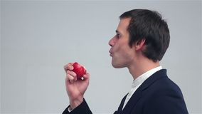 Young man eating an apple stock video