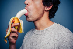 Young man eating banana Royalty Free Stock Photo