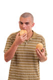 Young man eating buns with sesame Stock Photo