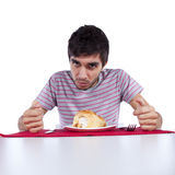 Young man eating a cake stock images