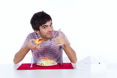 Young man eating a cake Royalty Free Stock Images
