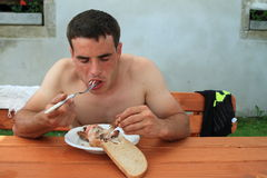 Young man eating chicken Royalty Free Stock Photo