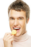 Young man eating chips Royalty Free Stock Photography