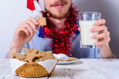 Young man eating christman gingerbread cookies Stock Image