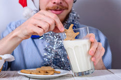 Young man eating christman gingerbread cookies Royalty Free Stock Image