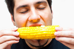 Young man eating corn Royalty Free Stock Photos