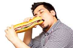 Young man eating a freshly made sub meat feast san Stock Images