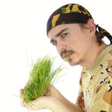 Young man eating grass Royalty Free Stock Images