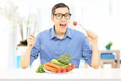 Young man eating a healthy meal at home Stock Image