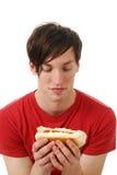 Young man eating a hot dog Royalty Free Stock Photo