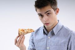 Young man eating pizza. White, young, handsome man  eating pizza Royalty Free Stock Image
