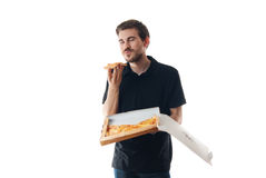 Young man eating pizza Stock Photos