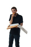 Young man eating pizza Stock Image
