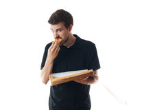 Young man eating pizza Stock Photography