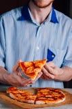 Young man eating pizza Margherita Stock Photos
