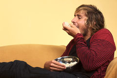 Young Man Eating Popcorn Stock Photography