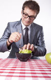 Young man eating salad. And smiling Stock Photo