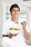 Young Man Eating A Salad stock images