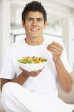 Young Man Eating A Salad Royalty Free Stock Images