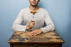 Young man eating sausage Royalty Free Stock Images