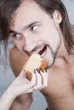 Young man eats a cake from female hands Royalty Free Stock Photos
